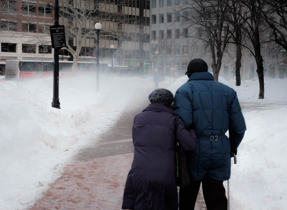 Elderly couple in blizzard, Copley square, Boston