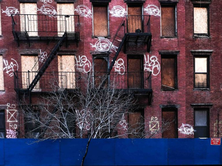 The blue fence, white tree, graffiti New York upper west side