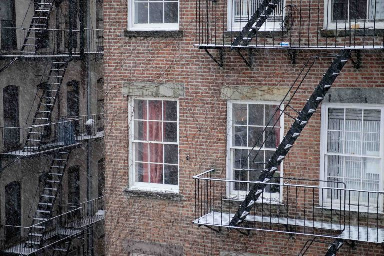 New York rear window view, fire escapes, snow falling