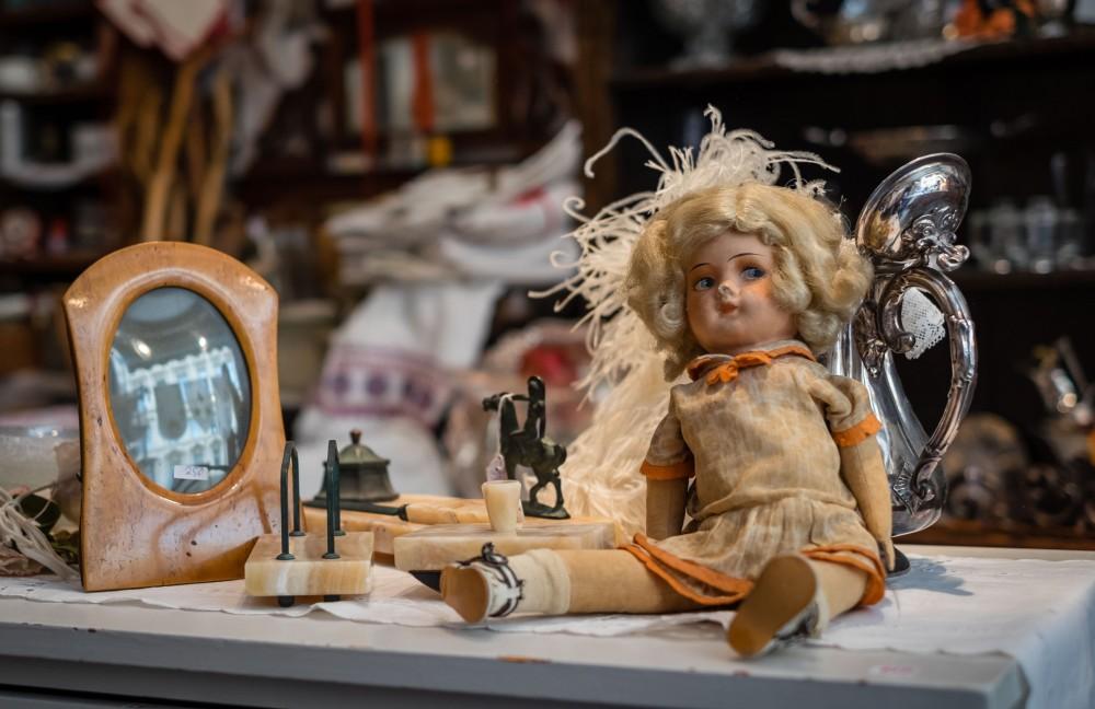 vintage porcelain doll in a Stockholm antique shop